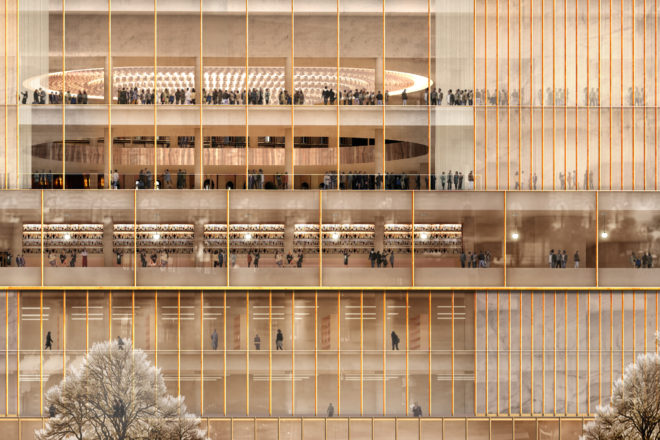 Large public building with a glass facade and a light interior.