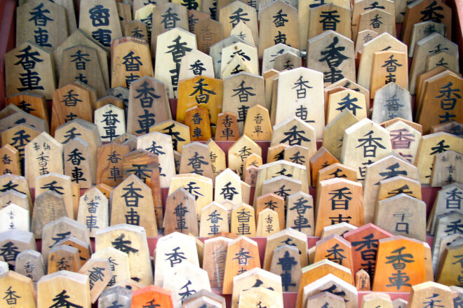 Hundreds of wooden signs with Japanese text on them.