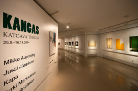 Kangas exhibition room with photographs on the wall.