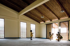 A large empty room with children