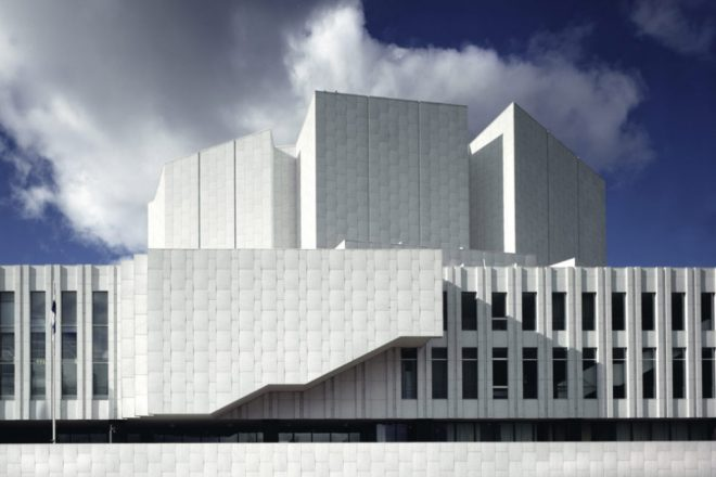 The façade of Finlandia Hall from the Töölö bay side on a partly cloudy day.