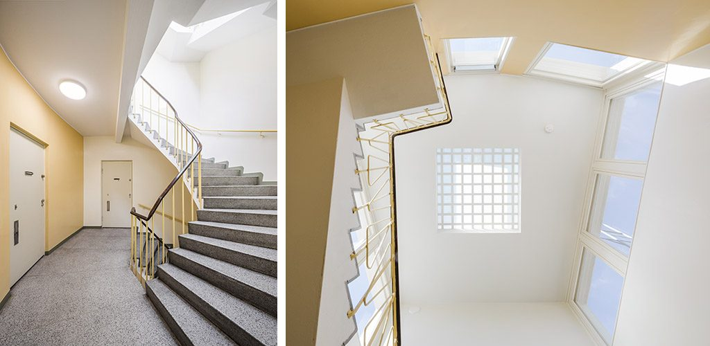 Restored staircases with natural light shining in.