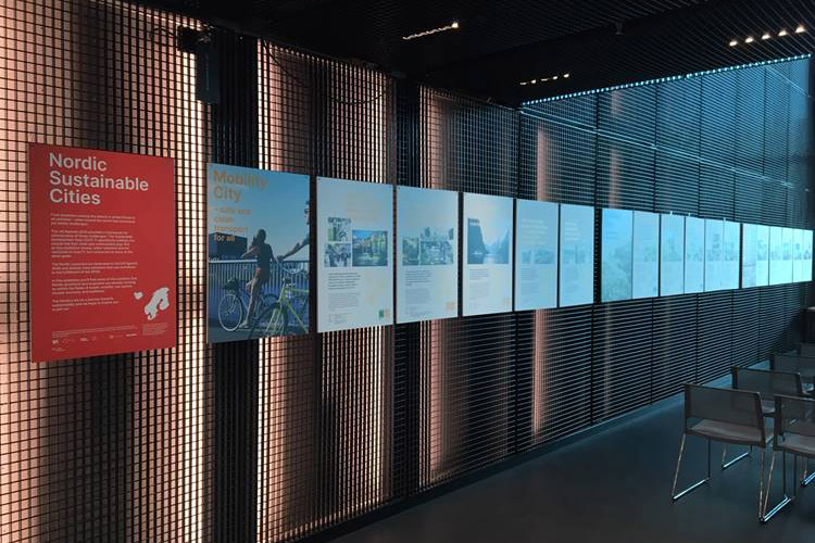 Exhibition material lined up on a wall.