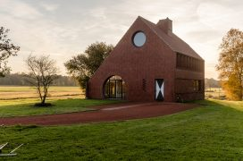 Residential house made of red bricks in the countryside.