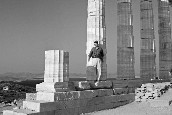 Architect Aarne Ervi leans on a pilar of the ruins of the Temple of Poseidon.
