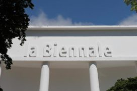 "La biennale's main pavilion's white facade that has an embossed text ""la Biennale""."