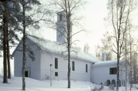 Muurame Church by Alvar Aalto. The church is white and covered with snow.
