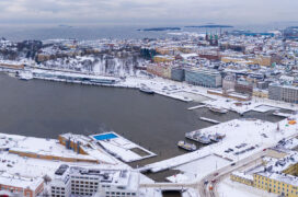 Aerial photo of the harbour area in the Centre of Helsinki. Snow on the ground, the sea is not frozen.