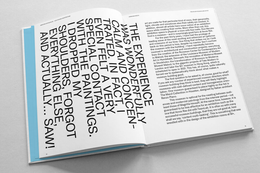 Open book, white spread with text, on the left page capital letter words vertically.